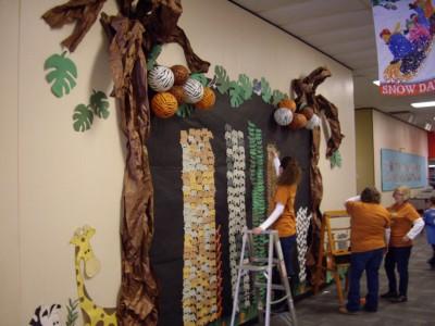 Staff members tally scores on the Safari display